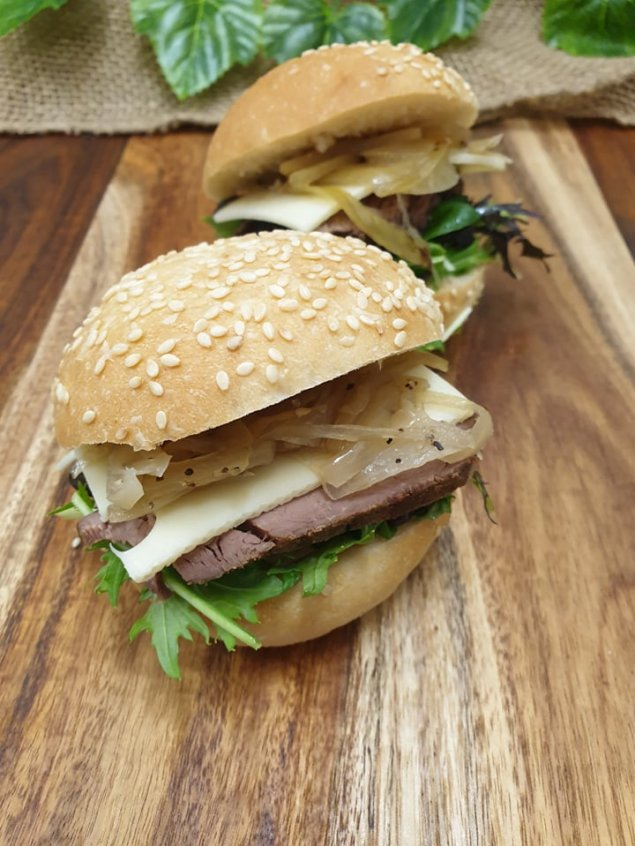 Sesame roll – Peppered beef, horseradish cream, braised onion, mesculn and Swiss cheese