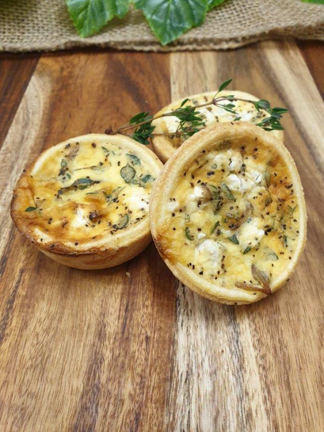 Saute onion, thyme, and goat's feta mini quiches (v)