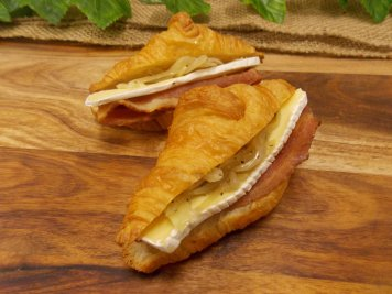 Mini croissant filled with bacon, braised onion & brie