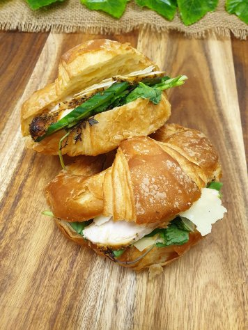 Croissant – Lemon pepper chicken, aioli, rocket, cucumber and shaved parmesan