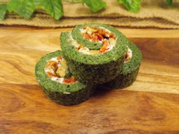 Spinach roulade filled with whipped ricotta, toasted walnuts and sundried tomatoes