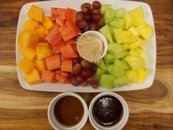 Chunky fruit served with chocolate & caramel dips