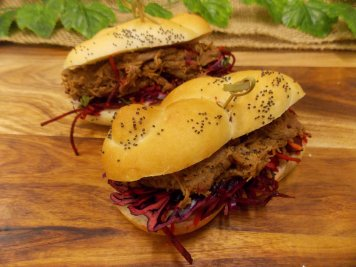 Poppy plait roll with spicy pulled beef & herbed beetroot slaw filling